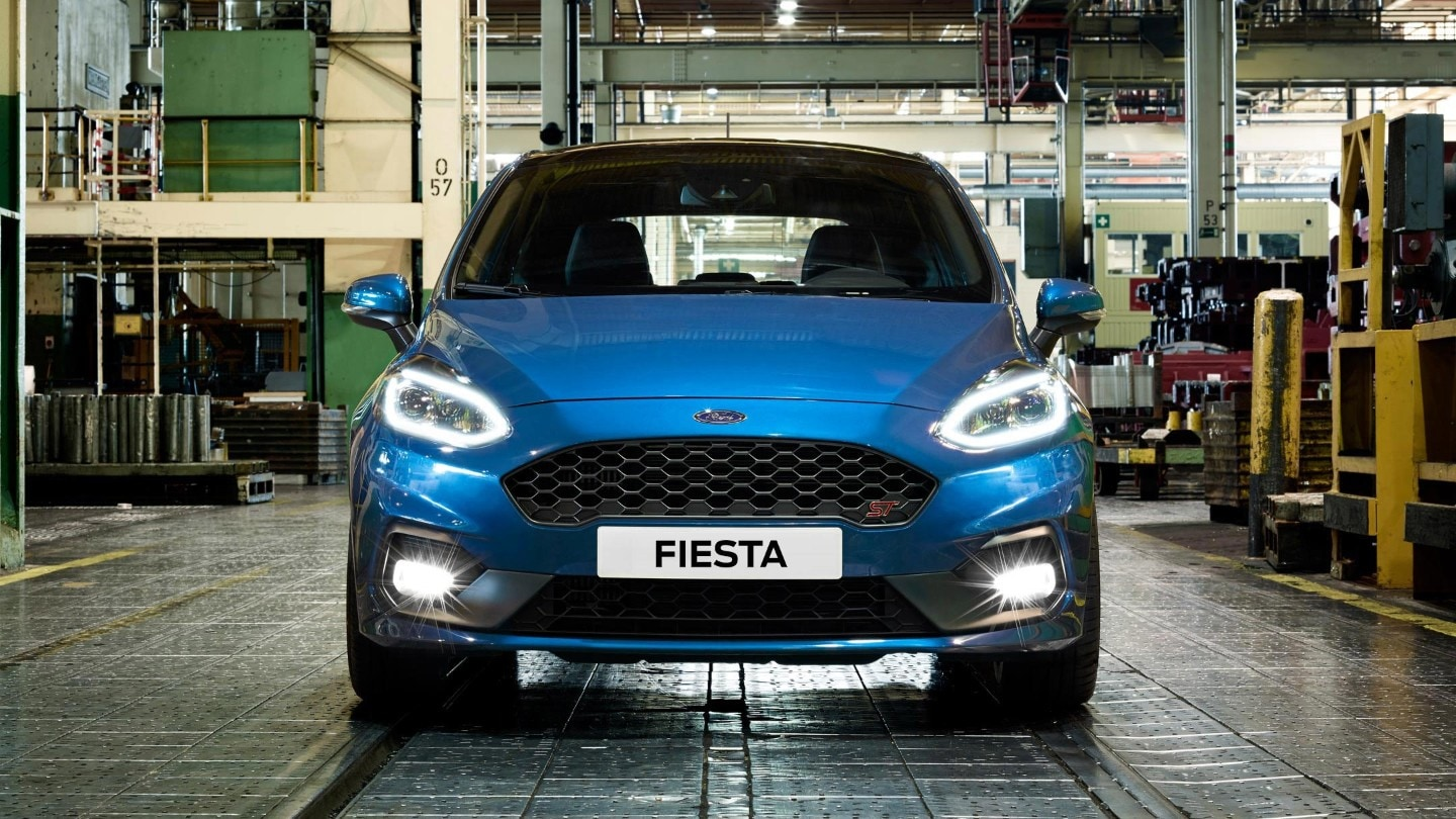 Blue Ford Fiesta ST in a warehouse front view