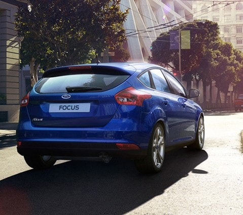Blue Ford Focus parked on the street rear view