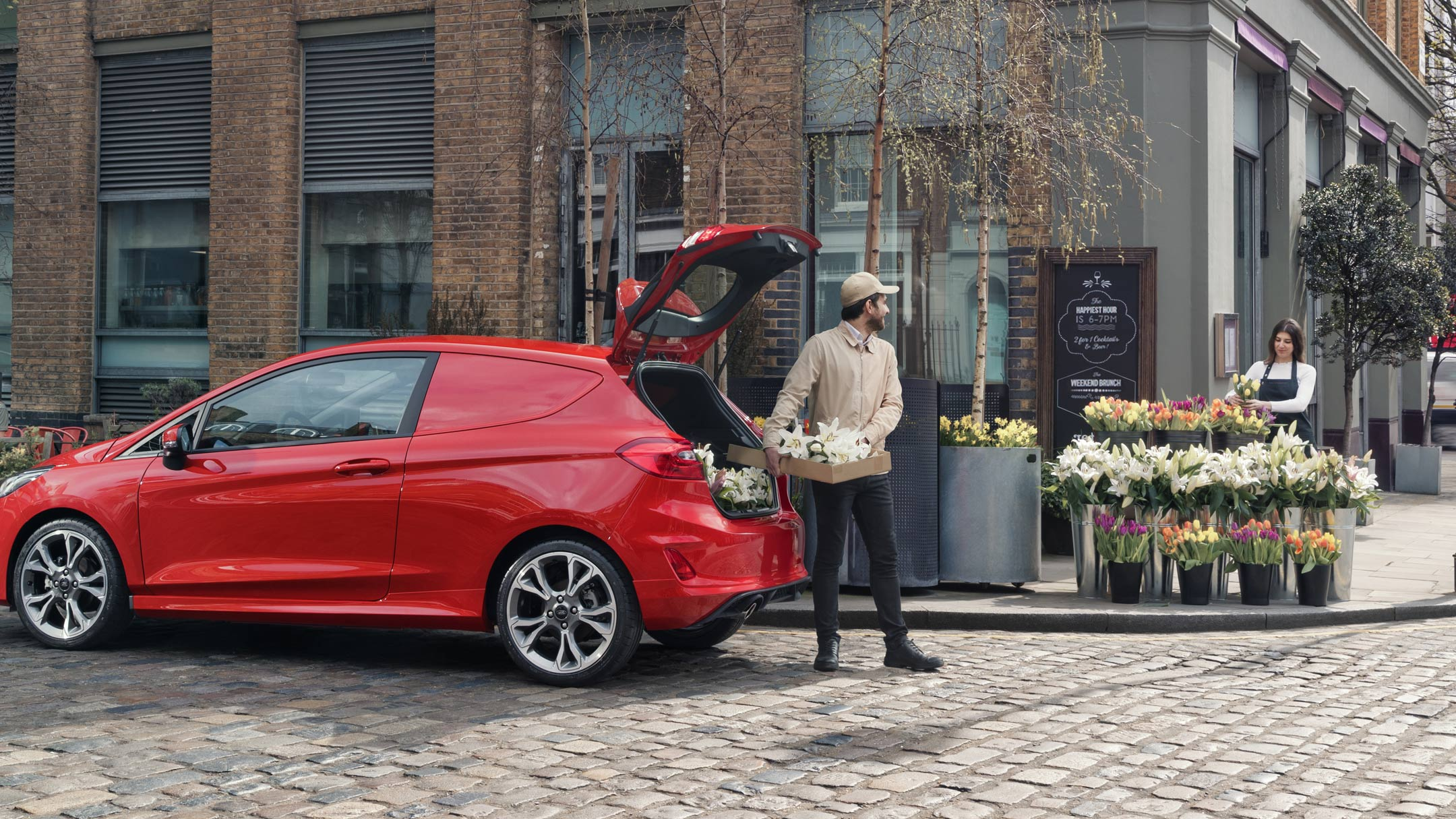 Ford Fiesta Van with man loading car