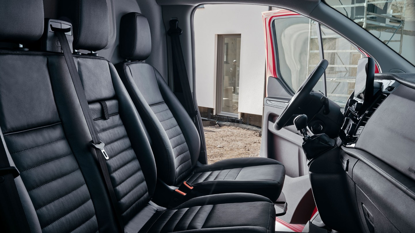 New Ford Transit Custom Trail interior with front seats, dashboard and steering wheel