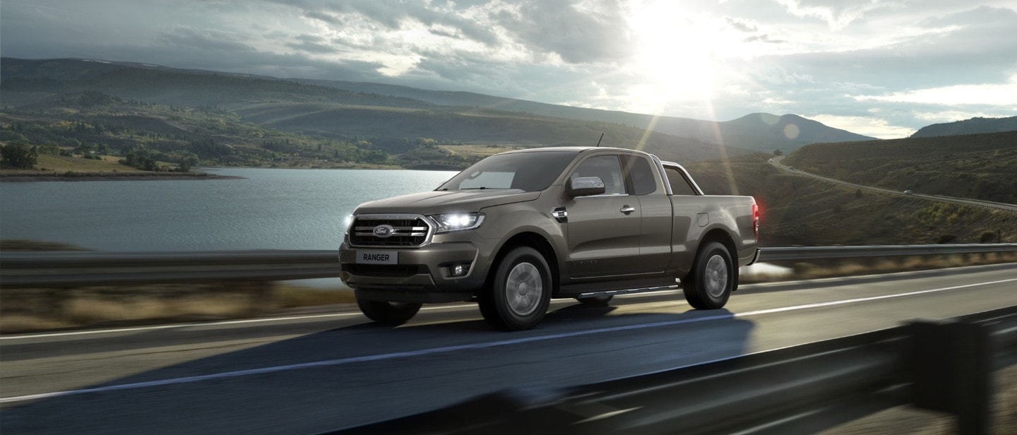 Ford Ranger Super Cab driving close to lake