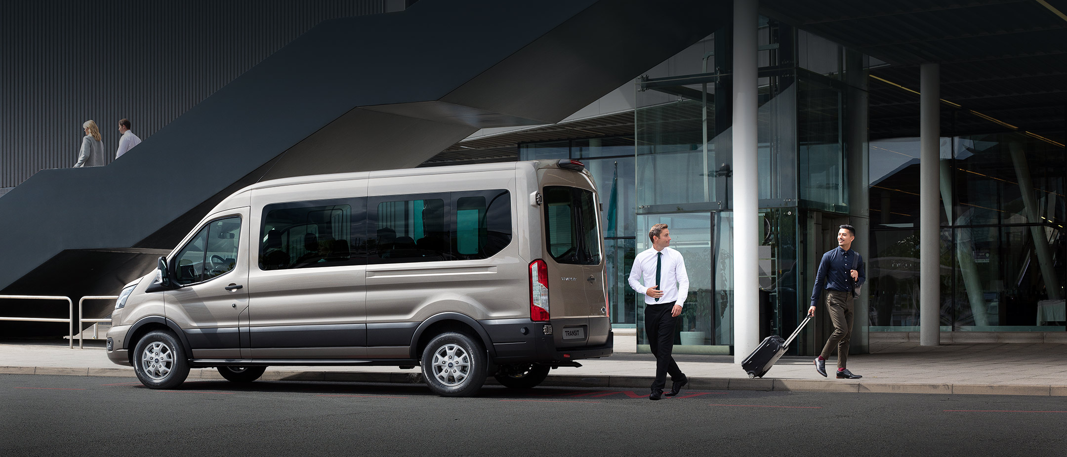 All New Ford Transit Minibus side view parked outside building