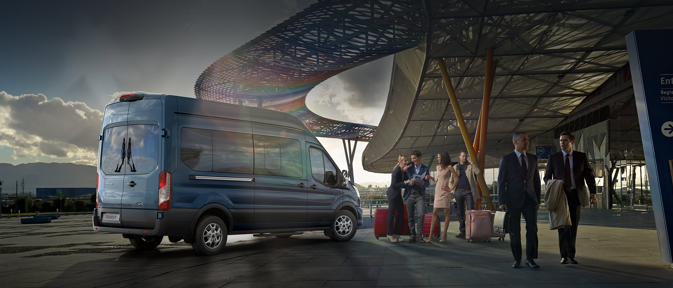 All New Ford Transit Minibus rear view parked outside airport