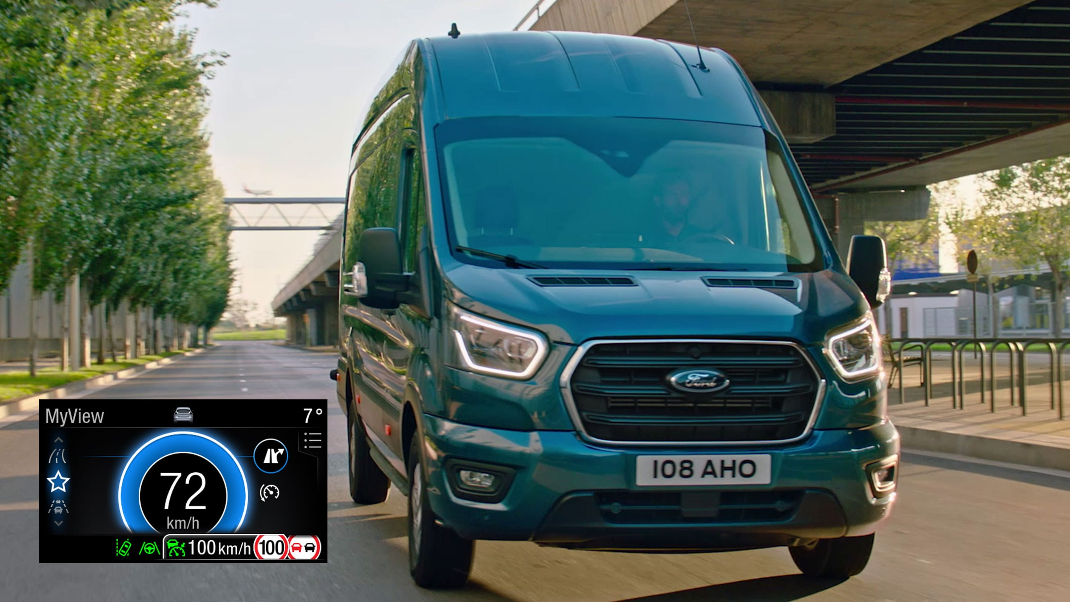 Ford Transit Van driving on motorway front view with Eco Mode dial in detail