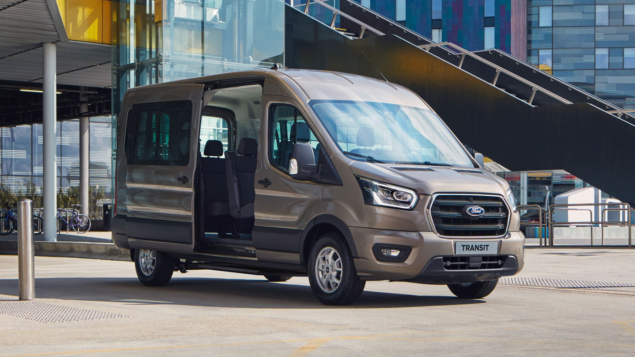 Ford Transit Minibus standing in front of building