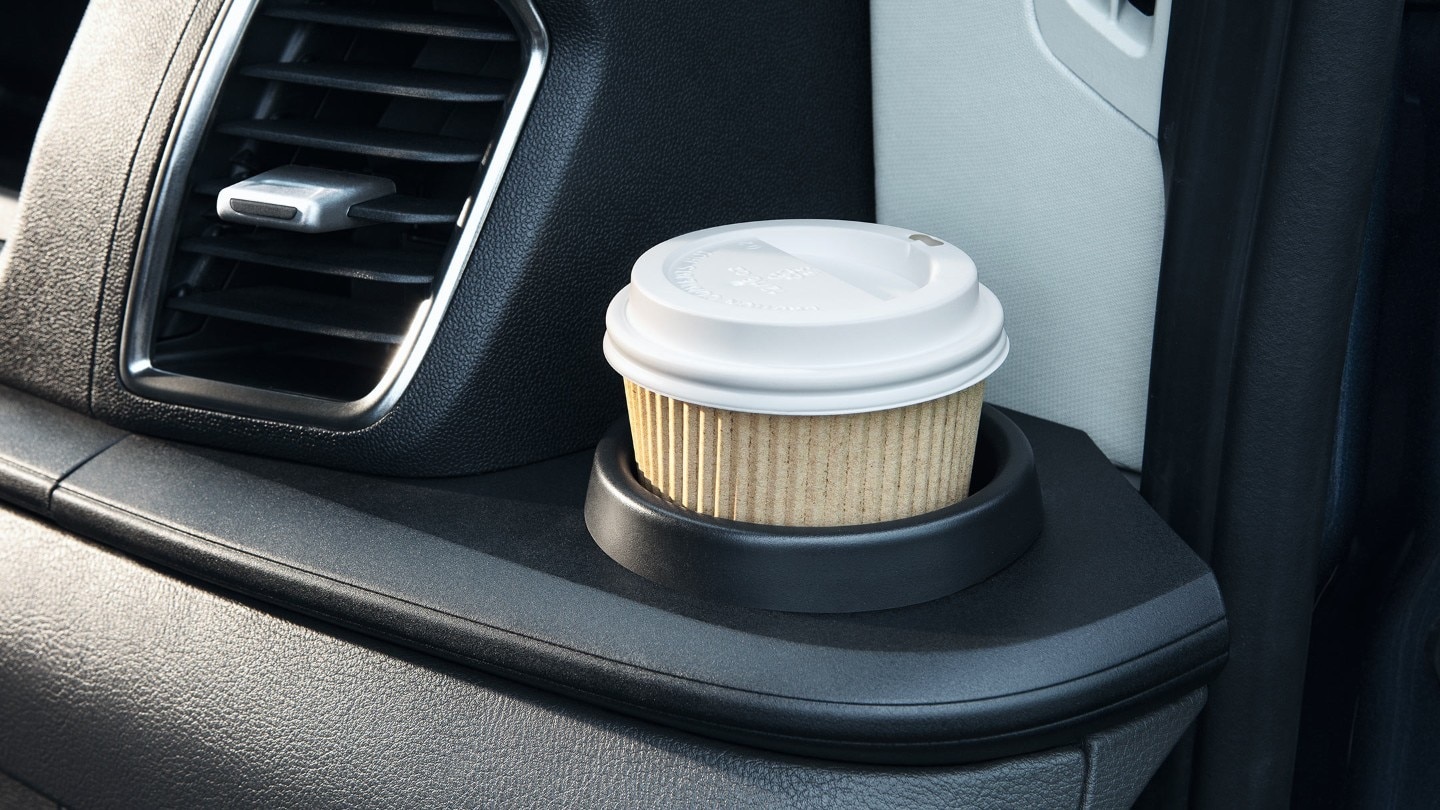 New Ford Transit Minibus interior showing coffee cup and stowage space
