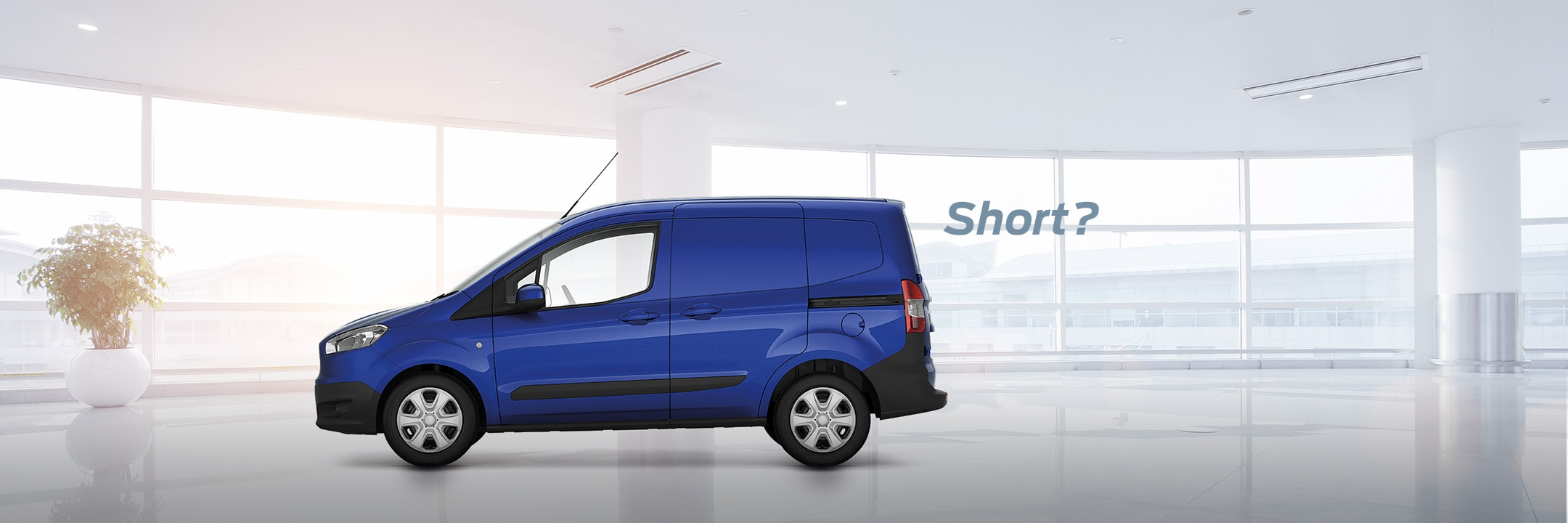 Ford Rental Transit Courier in blue parked in showroom
